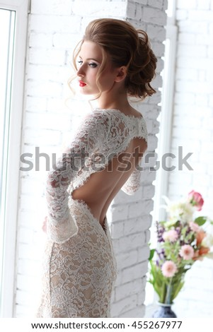 Closeup portrait of young beautiful bride, back view