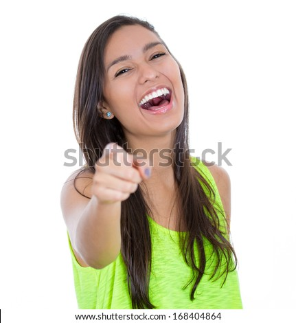 Closeup portrait of young, beautiful, excited, happy woman smiling, laughing, pointing finger towards you, to the camera, isolated over white background. Positive human emotions, attitude, reactions - stock photo