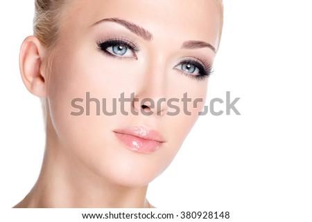 Closeup portrait of young beautiful white woman with long false eyelashes  over white background - stock photo