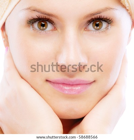 Closeup portrait of young beautiful woman after bath, isolated on white background.