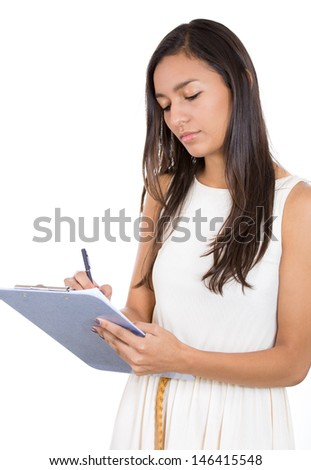 Closeup portrait of young, beautiful woman/student or businessperson writing serious notes, isolated on white background