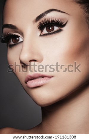 Closeup portrait of young beautiful  woman with long  eyelashes - stock photo