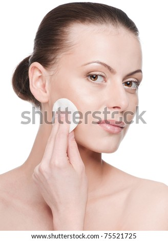 Closeup portrait of young beautiful woman with perfect skin. Applying clean sponge. Isolated - stock photo