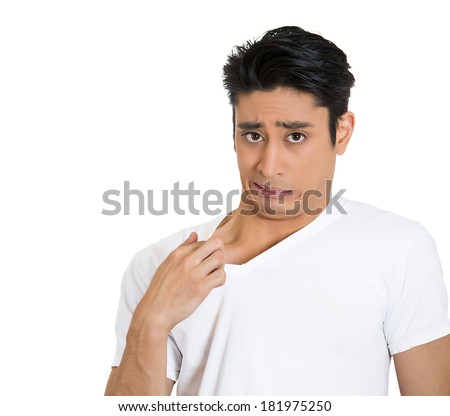 Closeup portrait of young business man opening shirt to vent, it's hot, unpleasant, awkward situation, embarrassment. Isolated white background. Negative human emotions, facial expression, feelings - stock photo