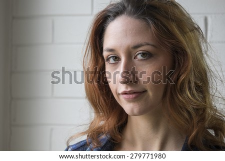 Closeup portrait of young caucasian woman looking happy, confident, and successful.