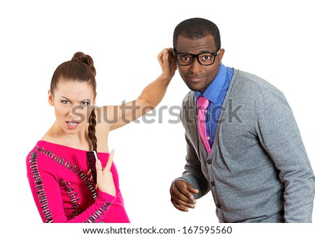 Closeup portrait of young couple, woman punishing man in big glasses, pinching squeezing ear for a mistake he committed. Relationship conflict difficulty. Negative emotion facial expressions feelings - stock photo