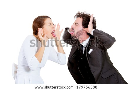 Closeup portrait of young funny looking couple man, woman sticking out tongues at each other, thumbs hands on temple, isolated on white background. Human emotion, facial expression, attitude, reaction - stock photo