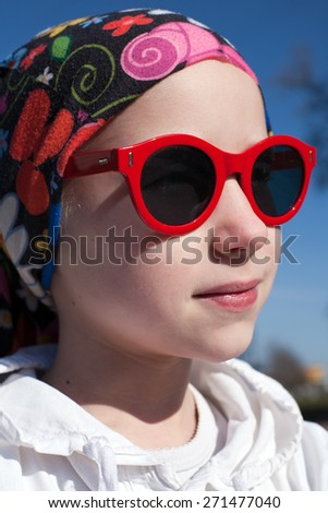 closeup portrait of young girl in bandana and big sunglasses - stock photo