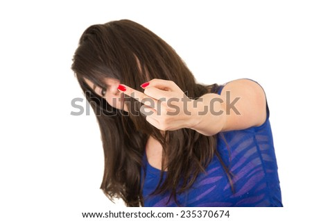 closeup portrait of young girl posing giving the finger gesturing subversion isolated on white - stock photo