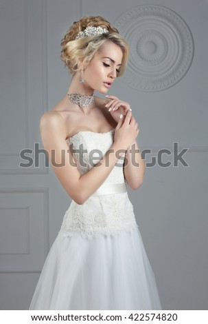 Closeup portrait of young gorgeous bride - stock photo