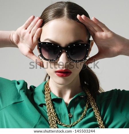 closeup portrait of young gorgeous caucasian woman wearing sunglasses with hands on face - stock photo