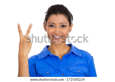 Closeup portrait of young happy confident excited pretty woman giving peace victory, two sign gesture, isolated on white background. Positive human emotion facial expression feelings symbols, attitude - stock photo