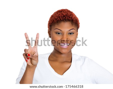 Closeup portrait of young happy smiling confident excited woman giving peace victory or two sign gesture, isolated on white background. Positive emotion facial expression feelings symbols, attitude - stock photo
