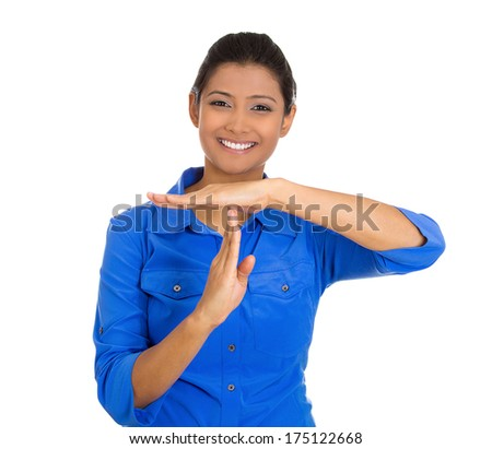 Closeup portrait of young happy smiling woman showing a time out gesture with hands isolated on white background. Negative emotion facial expression feelings, body language - stock photo