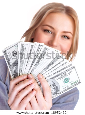 Closeup portrait of young lady holding in hands and showing a wad of american dollars, isolated on white background, business and finance concept - stock photo