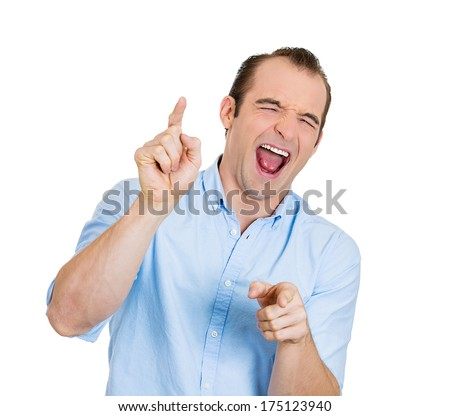 Closeup portrait of young laughing handsome excited, happy man pointing at you camera gesture with finger, isolated on white background. Positive emotion facial expression feelings, body language