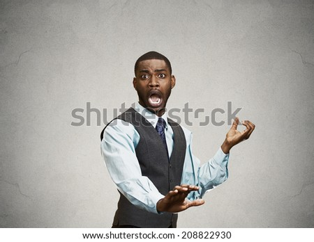 Closeup Portrait of young Man looking Shocked Scared trying to protect himself from unpleasant situation or object thrown at him, isolated black background. Negative emotion Facial Expression feeling - stock photo