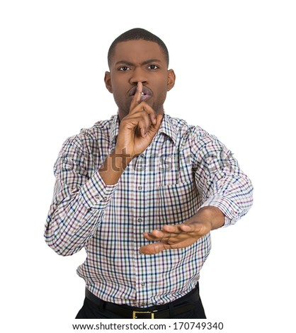 Closeup portrait of young man placing finger on lips to say, shhhhh, be quiet, gesture with hand isolated on white background. Negative facial expression feelings, human emotions signs and symbols - stock photo