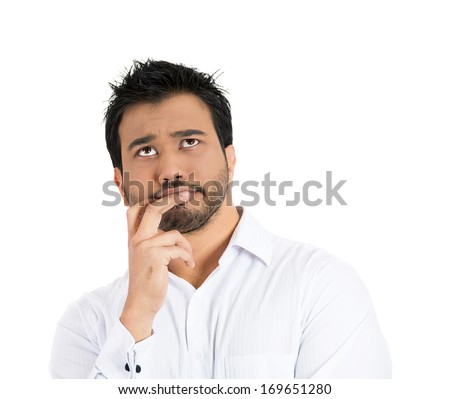 Closeup portrait of young man serious thinking daydreaming deeply about something bad chin on hand, eyes looking upwards, isolated on white background. Negative emotion facial expression feeling - stock photo