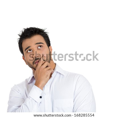 Closeup portrait of young man thinking daydreaming deeply about something with hand on temple looking upwards, isolated on white background copy space to right. Human facial expressions, signs symbols - stock photo