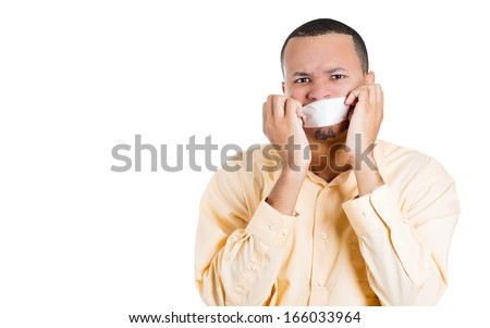 Closeup portrait of young moral afraid male adult man covering closed mouth, eyes open. Speak no evil concept, isolated on white background. Human emotion facial expression sign, symbol, feelings - stock photo