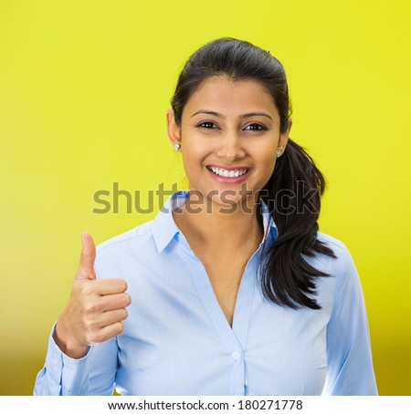 Closeup portrait of young pretty smiling woman, student,customer giving thumbs up sign, isolated on green background. Positive human emotions, facial expression feelings, signs, symbols, body language - stock photo