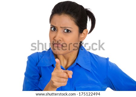 Closeup portrait of young pretty unhappy, serious woman pointing at someone as if to say you did something wrong, bad boy, isolated on white background. Negative emotions, facial expressions, feelings - stock photo