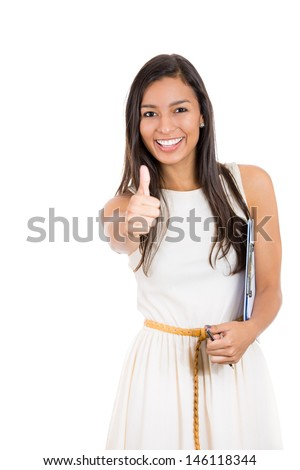 Closeup portrait of young pretty woman with one thumbs up sign gesture pointing at you, isolated on white background. Positive emotion facial expression feelings, signs and symbols, body language - stock photo