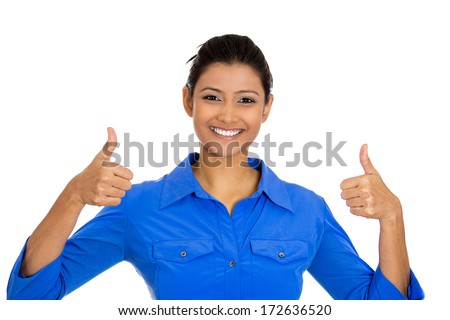 Closeup portrait of young pretty woman with two thumbs up sign gesture pointing at you, isolated on white background. Positive emotion facial expression feelings, signs and symbols, body language