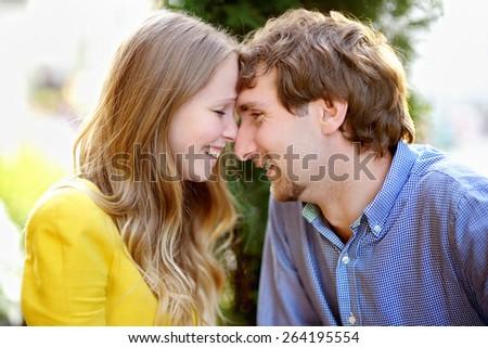 Closeup portrait of young romantic couple - stock photo