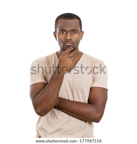 Closeup portrait of young sad serious man thinking daydreaming deeply something bad, chin on hand, eyes looking at you, isolated on white background. Negative emotions, facial expressions, feelings - stock photo
