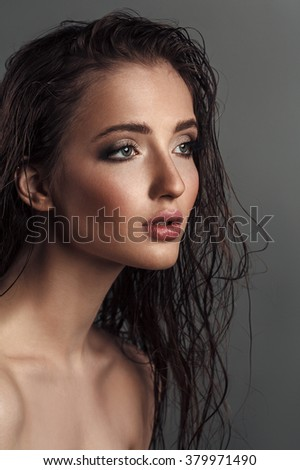 Closeup portrait of young sensual woman with wet hair. Beautiful fashion photoshoot of glamour female face - stock photo