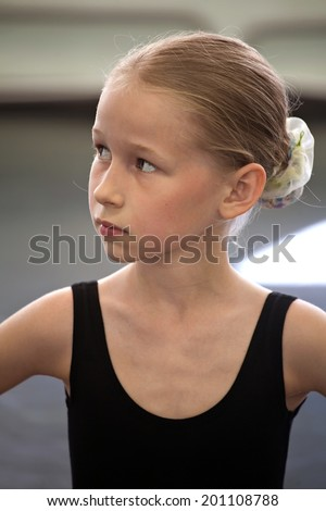 closeup portrait of young serious ballet girl  - stock photo