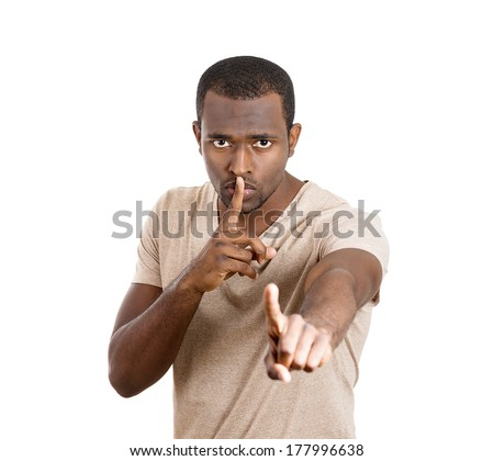 Closeup portrait of young serious man, coach, guy, student, leader placing finger on lips to say shhh, be quiet silence isolated on white background. Facial expressions, human emotions, signs, symbols - stock photo