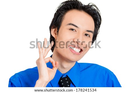 Closeup portrait of young silly goofy man gesturing with hands thumb to go out party and get drunk, hammered, wasted, tipsy, isolated on white background. Positive emotion facial expression feeling. - stock photo
