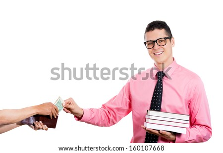 Closeup portrait of young smiling student man holding books in one hand and wallet in the other, looking happy, while receiving money for college tuition, isolated on white background. Education value - stock photo