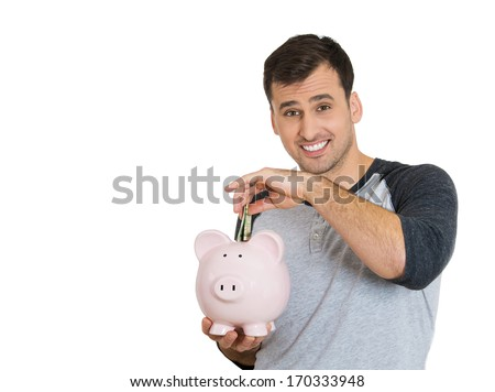 Closeup portrait of young smiling student, worker man holding piggy bank, depositing funds, isolated on white background. Smart currency financial investment decisions. Budget management and savings - stock photo