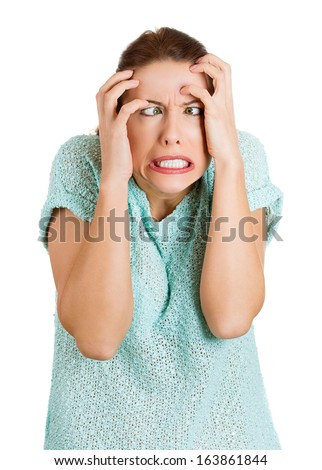Closeup portrait of young stressed, frustrated, annoyed, pissed off, mad woman with hands on head, eyes crossed, going insane, isolated on white background. Negative human emotions facial expressions - stock photo