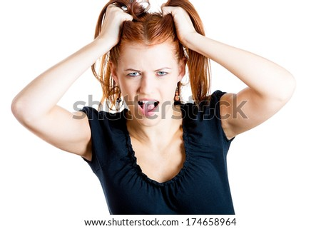 Closeup portrait of young stressed woman pulling her hair out about to have nervous breakdown, isolated on white background. Negative human emotions, facial expressions, reactions, attitude, feeling