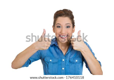 Closeup portrait of young successful smiling woman, student being excited, giving thumbs up, isolated on white background. Positive human emotions, facial expressions, feeling, signs, symbol, attitude - stock photo