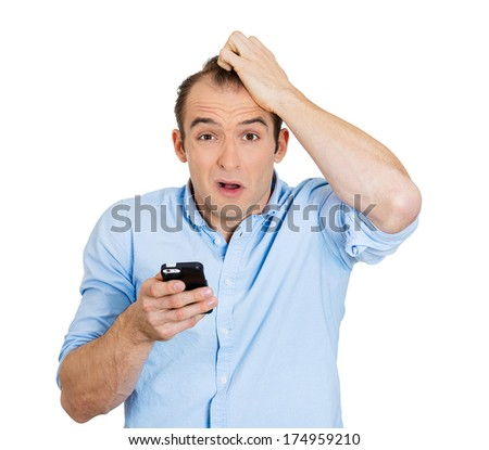 Closeup portrait of young surprised stunned shocked pissed man who is not happy by what he sees on his cellular phone, isolated on white background. Negative human emotion facial expression feelings - stock photo