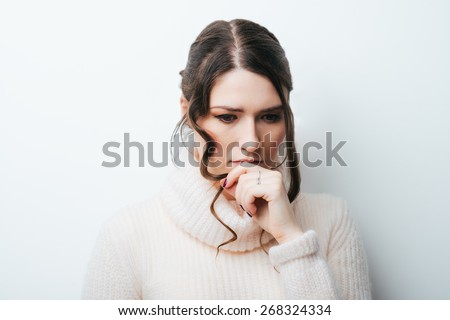 Closeup portrait of young unhappy woman, biting her nails looking at you with craving for something, anxious, worried. Negative emotions, facial expression, feelings - stock photo