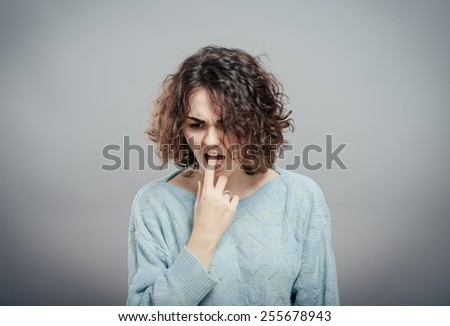 Closeup portrait of young woman, annoyed, frustrated  fed up sticking fingers in her throat showing she is about to throw up. Case anorexia nervosa, Isolated