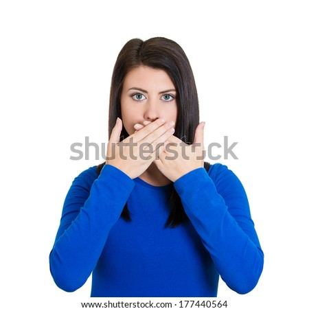 Closeup portrait of young woman covering closed mouth, open eyes. Speak no evil concept, isolated white background. Negative human emotions, facial expressions signs and symbols. Media news coverup - stock photo
