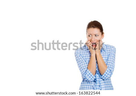 Closeup portrait of young woman scared, afraid, shocked, nervous, terrified of unexpected insult, impact, looking to the left, isolated on white background. Negative human emotions, facial expressions
