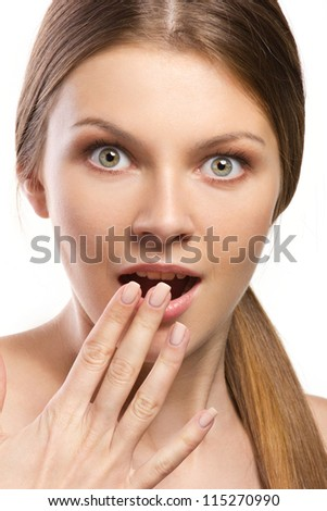 closeup  portrait of young woman staring at camera on white background - stock photo