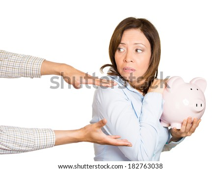Closeup portrait of young woman, student, holding piggy bank, looking scared, angry, frustrated trying to protect her savings from being stolen, isolated on white background. Financial fraud, robbery - stock photo