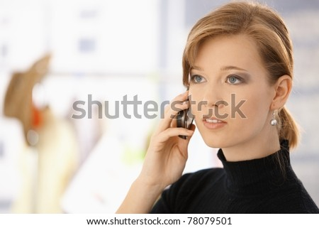 Closeup portrait of young woman, talking on mobile phone.? - stock photo