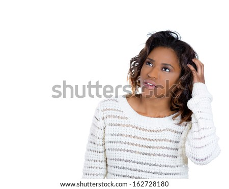 Closeup portrait of young woman thinking daydreaming deeply about something scratching head looking upwards, isolated on white background copy space to left. Human facial expressions signs symbols