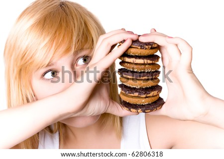 closeup portrait of young woman with chocolate chip cookies - stock photo